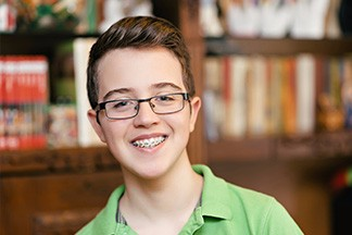 Teen in glasses with braces
