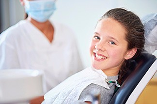 Young girl smiling in exam chair